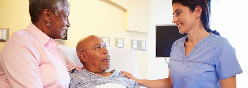 Aide helping family home-health-aide