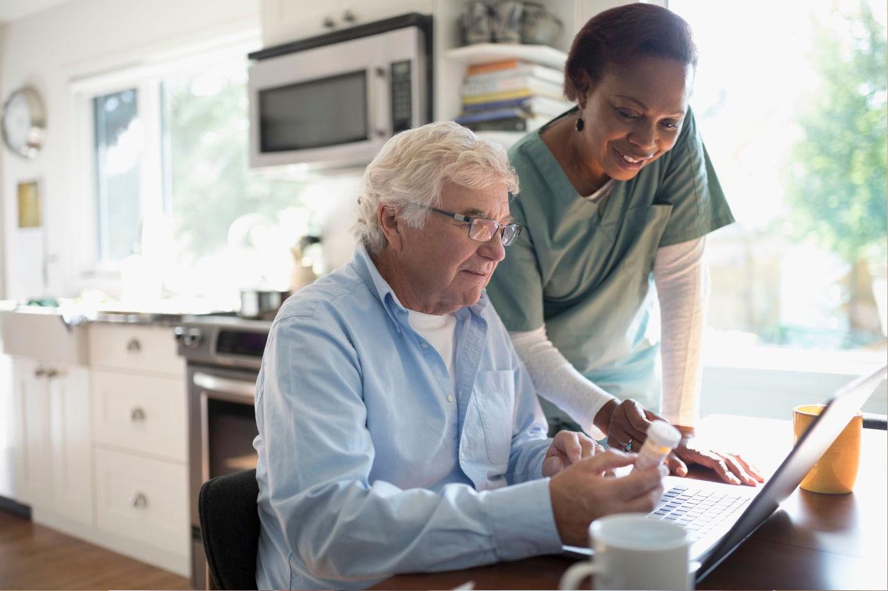 female-home-nurse-helping-senior-male-patient-reordering-prescription-medication-at-laptop-915090108-5c4767e2c9e77c0001da457c
